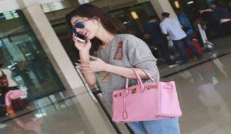 Phong cách thời trang balo túi xách sân bay của các sao Việt